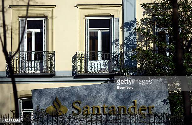 The Santander banking logo is seen outside an office building for Banco Santander SA located on the Paseo de la Castellana in Madrid Spain on...