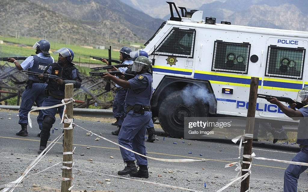 The SAPD attempt to control the protest at the N1 De Doorns protest on January 9, 2013, in Cape Town, South Africa. Farm workers shut down the N1 by lighting tires on fire and placing large rocks on the road in an attempt to negotiate R150 a day wages.