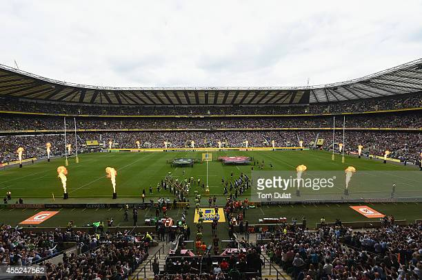 The Saracens and Northampton teams walk onto the pitch for the Aviva Premiership Final between Saracens and Northampton Saints at Twickenham Stadium...