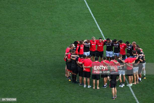 The Saracens huddle up for warm ups before playing against the Newcastle Falcons during a Aviva Premiership match between the Newcastle Falcons and...