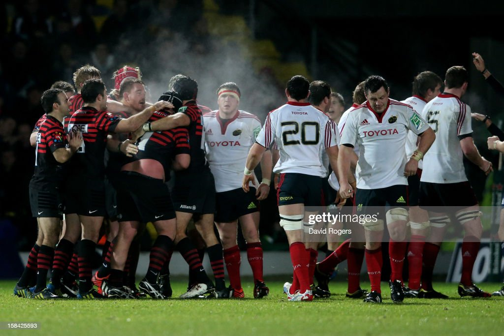 The Saracens pack celebrate winnning a late scrum as the dejected Munster forwards look on during the Heineken Cup pool one match between Saracens and Munster at Vicarage Road on December 16, 2012 in Watford, United Kingdom.