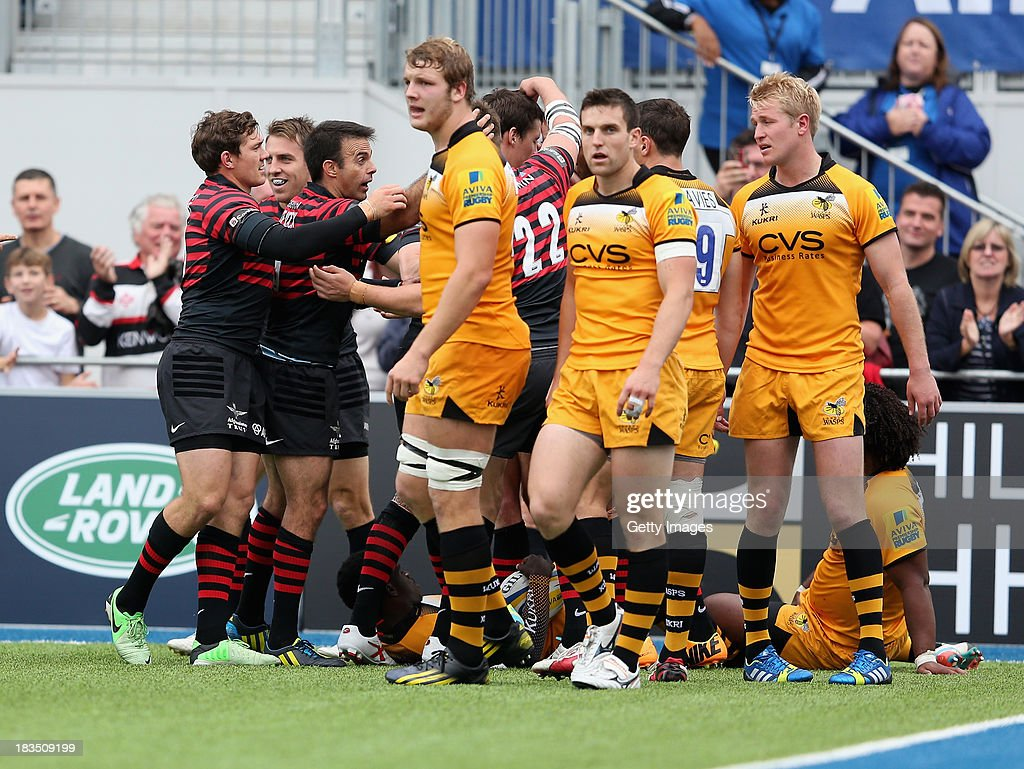 The Saracens team celebrate th try of Will fraser during the Aviva Premiership match between Saracens and London Wasps at Allianz Park on October 5, 2013 in Barnet, England.