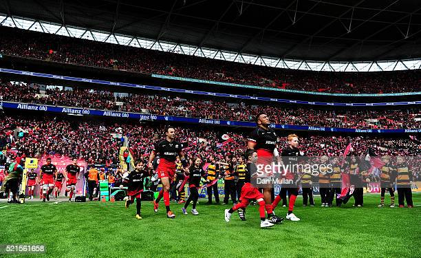 The Saracens team make their way onto the pitch prior to the Aviva Premiership match between Saracens and Harlequins at Wembley Stadium on April 16...