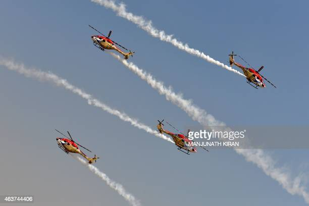 The Sarang aerobatics team of the Indian Air Force fly Advanced Light Helicopters at Yelahanka Airforce Station in Bangalore on February 18 on the...
