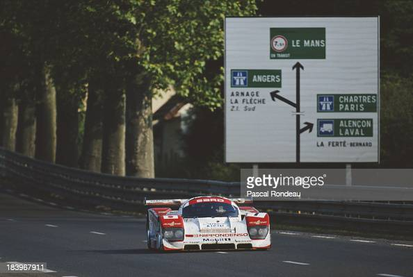 The SARD Company Ltd Toyota 94CV turbo driven by Eddie Irvine Jeff Krosnoff and Mauro Martini passes the road sign out of Tertre Rouge during...