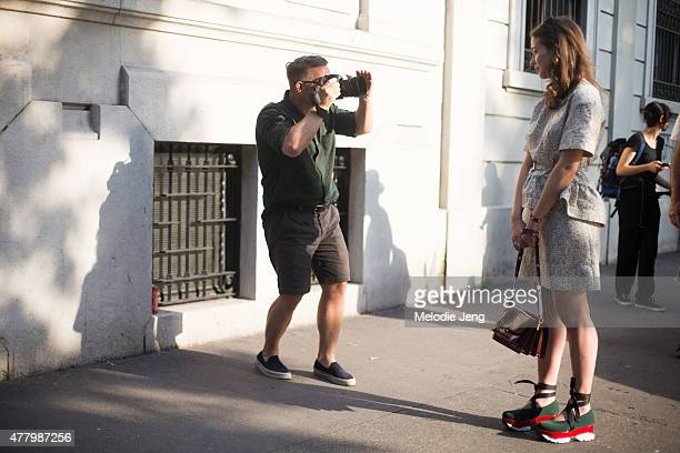 The Sartorialist Scott Schuman photographs a showgoer during Milan Men's Fashion Week Spring/Summer 2016 on June 20 2015 in Milan Italy