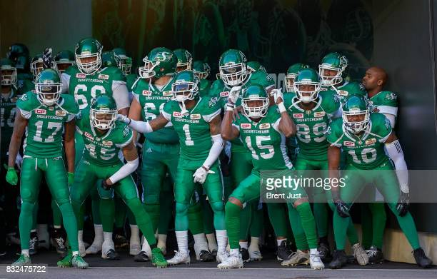 The Saskatchewan Roughriders about to take the field for the game between the BC Lions and the Saskatchewan Roughriders at Mosaic Stadium on August...