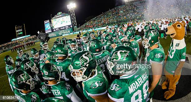 The Saskatchewan Roughriders group together before the game between the Hamilton TigerCats and Saskatchewan Roughriders at Mosaic Stadium on...