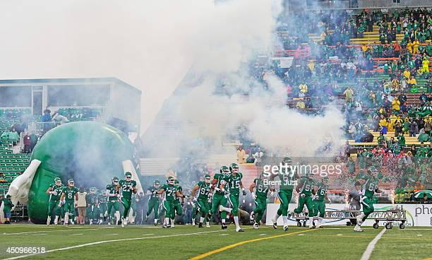 The Saskatchewan Roughriders take the field for a preseason game between the Edmonton Eskimos and Saskatchewan Roughriders at Mosaic Stadium on June...