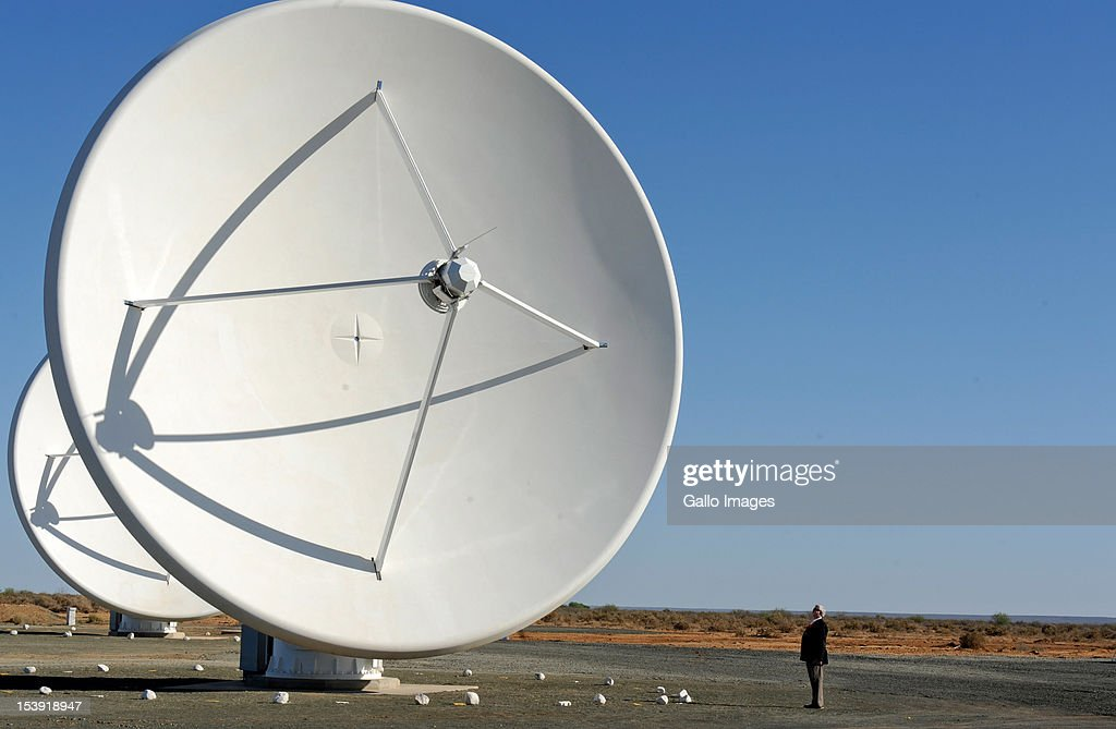 The satellite dishes that make up the KAT radio telescope stand in the sun at the SKA (Square Kilometre Array) project site on October 9, 2012 in Carnavon, South Africa. President Zuma called the project an opportunity to recruit young people to pursue careers in science and technology. The SKA - or Square Kilometre Array, already includes seven telescope dishes and will feature many more from 2013 onwards.