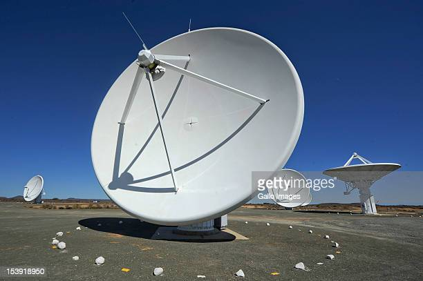 The satellite dishes that make up the KAT radio telescope stand in the sun at the SKA project site on October 9 2012 in Carnavon South Africa...
