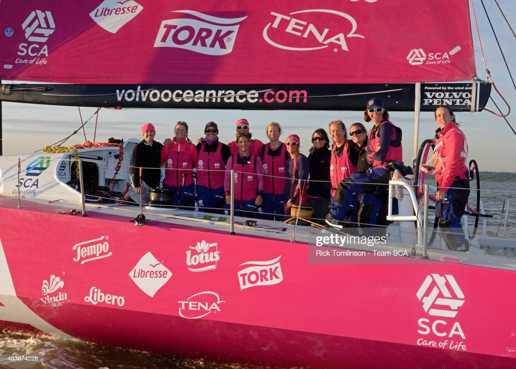 The SCA crew pose for a team photo as Team SCA's Volvo Ocean 65 skippered by Sam Davies finishes at dawn, beating the all female round Britain record, during the Sevenstar Round Britain and Ireland Race 2014 off the Royal Yacht Squadron August 16, 2014 Cowes, Isle of Wight, England. Team SCA crossed the finish line of the 1880nm race at 06.10.39 BST on Saturday 16th August 2014 with an elapsed time of 4 days, 21 hours, 00 minutes and 39 seconds. This breaks the previous World Record for Women's Monohull set by Aviva, an Open 60, in 2009, by 1 day, 14 hours, 30 minutes and 14 seconds. SCA's record is subject to ratification by the World Speed Sailing Record Council. Among the women onboard SCA in 2014, both Dee Caffari and Sam Davies were also onboard Aviva when the World Record was set in 2009.