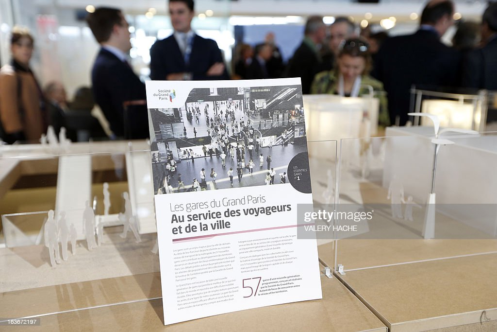 The scale model of the 'Gares du Grand Paris' project is on display on March 14, 2013 at the Palais des Festivals in Cannes, southeastern France, where takes place the MIPIM, an international real estate show for professionals. The event takes place until March 15. AFP PHOTO / VALERY HACHE