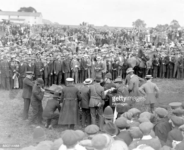 The scene after the incident involving suffragette Emily Davison during the Derby in 1913 Herbert Jones the jockey of the King's horse Anmer is...