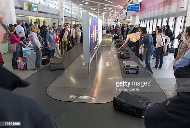 The scene at a baggage reclaim carousel at Tegel Airport pictured on May 08 2013 in Berlin Germany