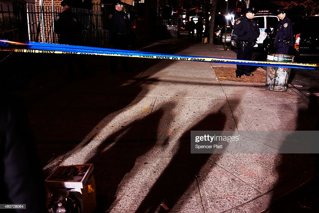 The scene at a shooting where two New York City police officers were killed execution style Saturday afternoon as they sat in their marked police car...
