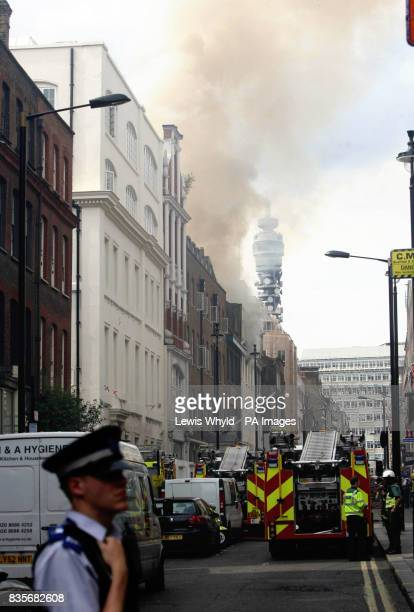 The scene in Dean Street London where sixty firefighters are tackling a fire in what is believed to be an office block