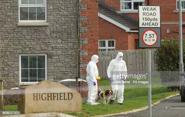 The scene in Highfield Close Omagh as forensic PSNI officers work at the scene after Catholic police officer Ronan Kerr was killed yesterday by a...