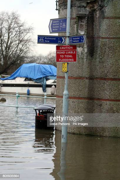 The scene in Richmond Upon Thames Surrey after the River Thames burst it banks at high tide
