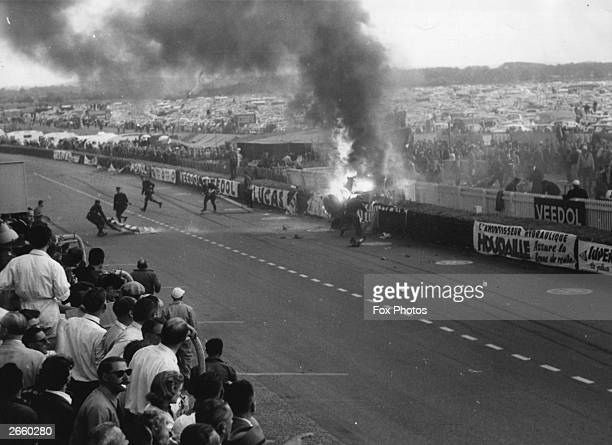 The scene of the crash at Le Mans racing circuit after Pierre Levegh's MercedesBenz 300 SLR spun out of control and exploded into the tightly packed...