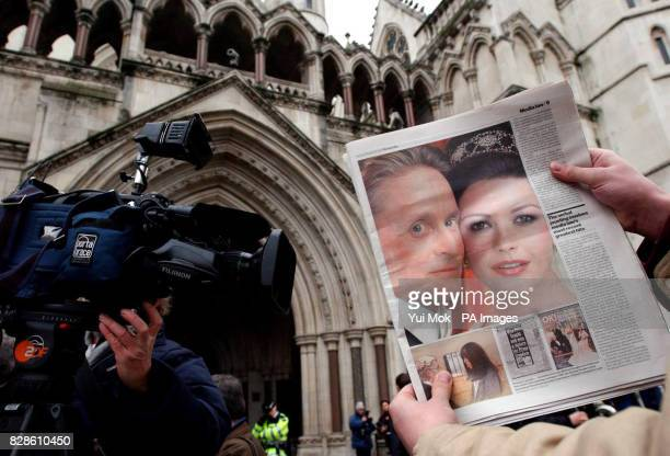 The scene outside the High Court in London where Catherine Zeta Jones and her husband Michael Douglas are due to give evidence in their claim for...