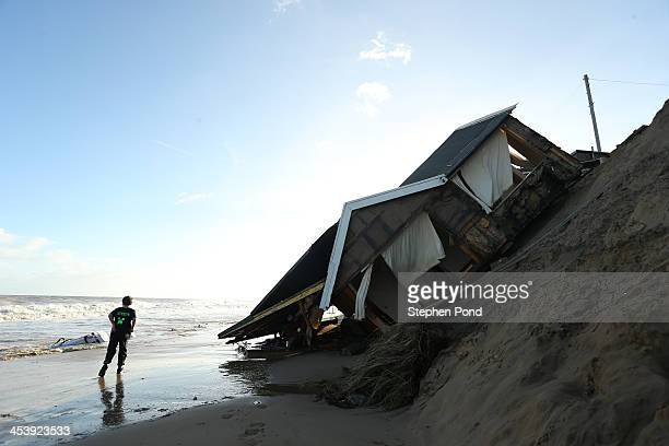 The scene where properties have fallen into the sea due to the cliff collapsing on December 6 2013 in Hemsby England Thousands of people were...