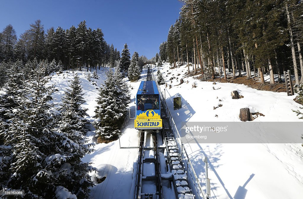 The Schatzalp funicular railway climbs a mountain above the town of Davos, Switzerland, on Friday, Jan. 18, 2013. Next week the business elite gather in the Swiss Alps for the 43rd annual meeting of the World Economic Forum in Davos, the five day event runs from Jan. 23-27. Photographer: Chris Ratcliffe/Bloomberg via Getty Images