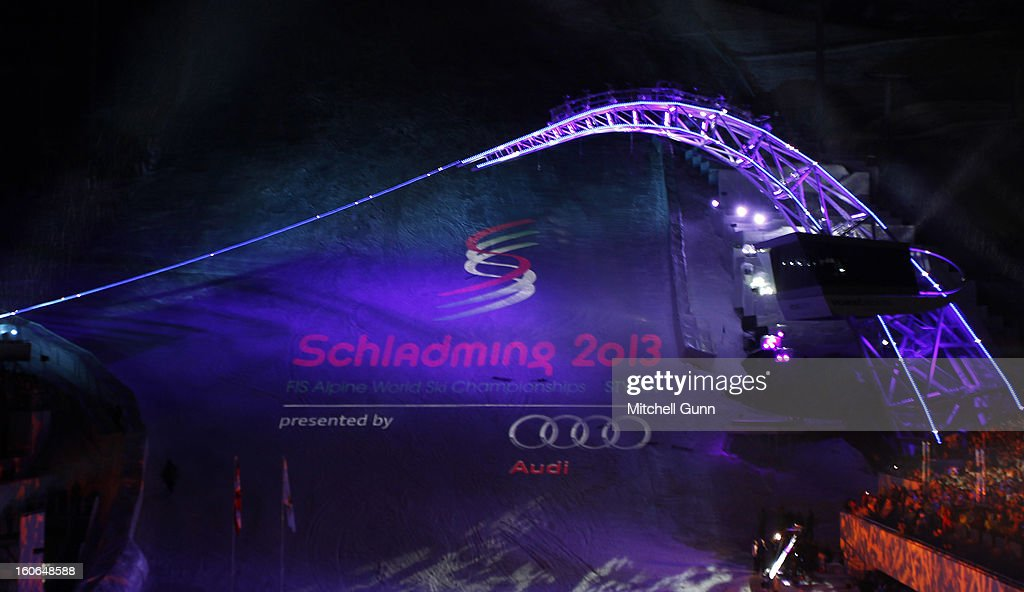 The Schladming 2013 logo is projected onto the race hill under an illuminated 'Sky Bridge' during the opening ceremony for the Alpine FIS Ski World Championships on February 04, 2013 in Schladming, Austria,