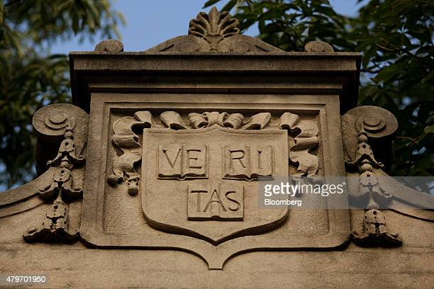 The school motto 'Veritas' is inscribed over a gate at the Harvard University campus in Cambridge Massachusetts US on Tuesday June 30 2015 Harvard...