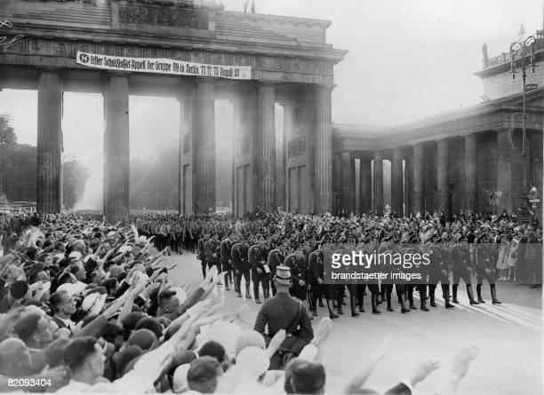 The 'Schutzstaffel' is marching through the Brandenburg Gate Photograph Berlin August 1933 [Die 'Schutzstaffel' marschiert durch das Brandenburger...