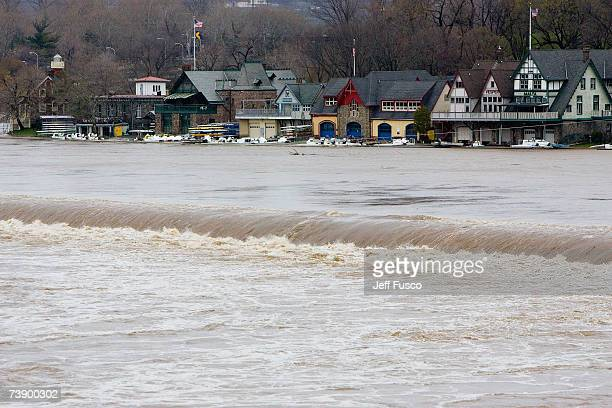 The Schuylkill River surges past Boathouse Row April 16 2007 in Philadelphia Pennsylvania A powerful nor'easter dumped record rainfall accompanied by...
