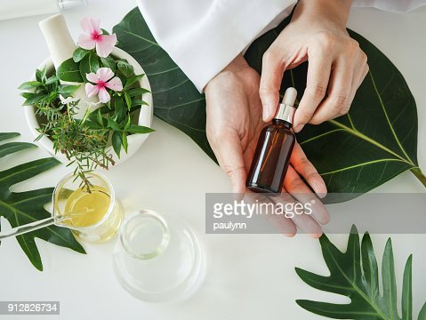 the scientist,dermatologist with the organic natural product in the laboratory.research and development beauty skincare concept.blank package,bottle,container .cream,serum.hand : Stock Photo