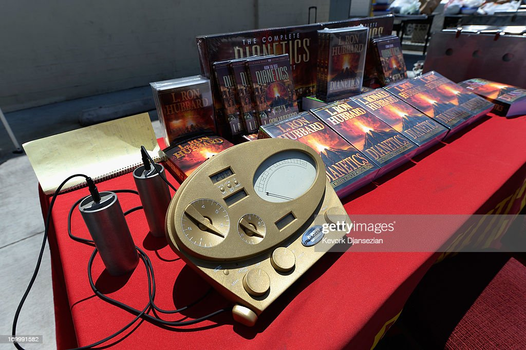 The Scientology EMeter and cans are show along with books by L Ron Hubbard founder of Chruch of Scientology at the Church of Scientology community...