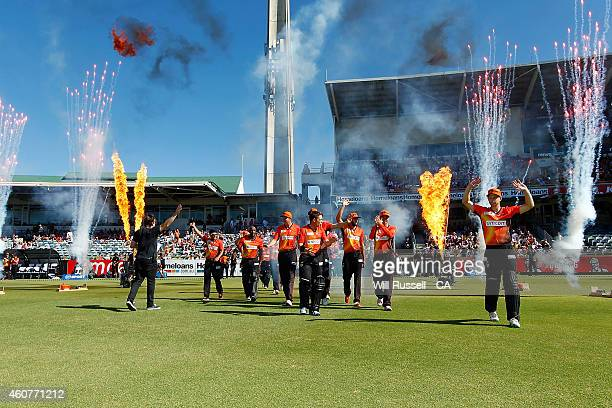 The Scorchers enter the field to present the 201314 Championship trophy to the fans during the Big Bash League match between the Perth Scorchers and...