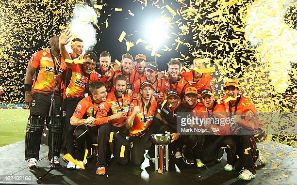The Scorchers pose for photos and celebrate winning the Big Bash League final match between the Sydney Sixers and the Perth Scorchers at Manuka Oval...