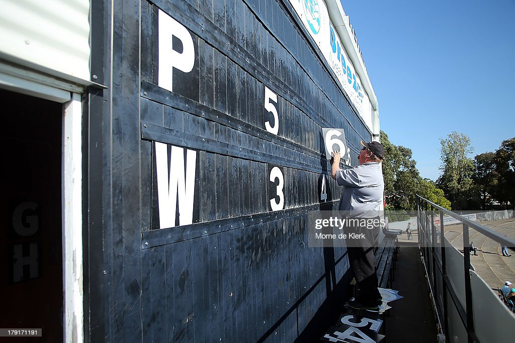 The score keeper adjusts the score board during the round 22 SANFL match between the Port Adelaide Magpies and the West Adelaide Bloods at Alberton Oval on September 1, 2013 in Adelaide, Australia.