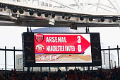 The scoreboard at the Emirates shows Arsenal 3 goal up at half time during the Barclays Premier League match between Arsenal and Manchester United at...