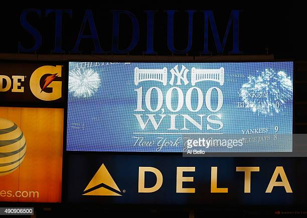 The scoreboard flashes the New York Yankees 10000 regular season win total after their 41 defeat of the Boston Red Sox at Yankee Stadium on October 1...