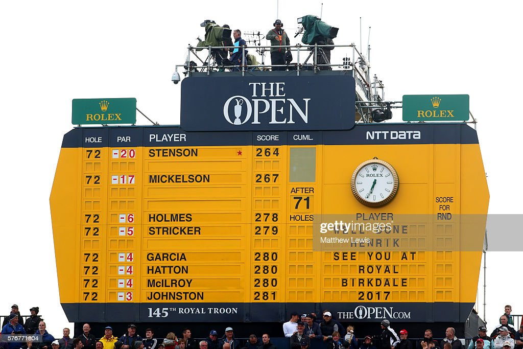 The scoreboard Henrik Stenson of Sweden's celebrates victory after the final round on day four of the 145th Open Championship at Royal Troon on July...