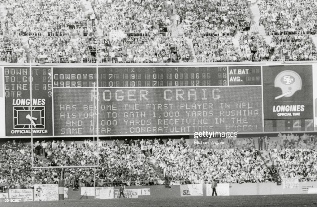 The scoreboard honors fullback Roger Craig of the San Francisco 49ers for becoming the first player in NFL history to gain 1000 yards rushing and...