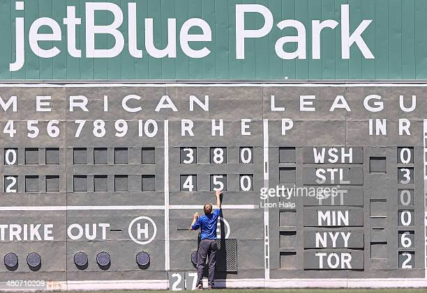 The scoreboard in left field gets updated between innings during the game between the Baltimore Orioles and the Boston Red Sox at JetBlue Park at...