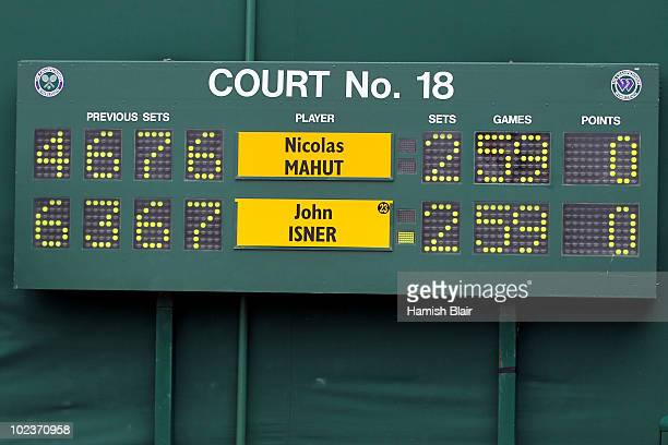 The scoreboard is seen as Nicolas Mahut of France plays against John Isner of USA during the third day of their first round match on Day Four of the...