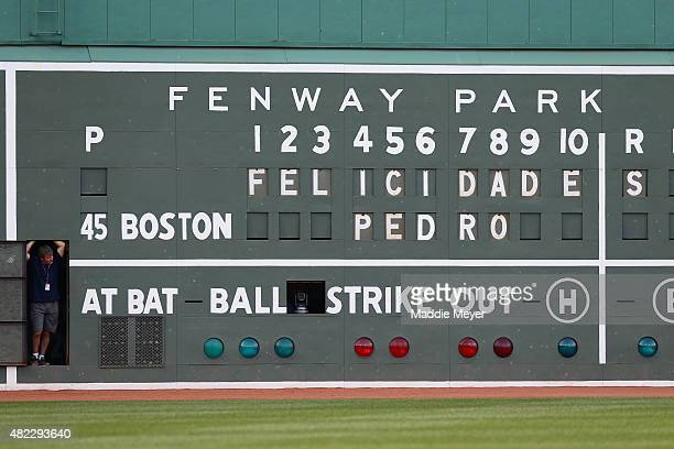The scoreboard on the Green Monster displays a message for Pedro Martinez during a ceremony to retire Martinez's number45 before a game against the...
