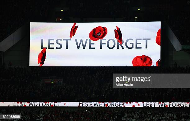 The scoreboard reads 'Lest We Forget' in remembrance of Armistice Day prior to the FIFA 2018 World Cup qualifying match between England and Scotland...