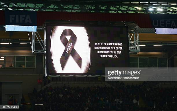 The scoreboard remember the victims of the recent Germanwings air crash prior to the international friendly match between Germany and Australia at...