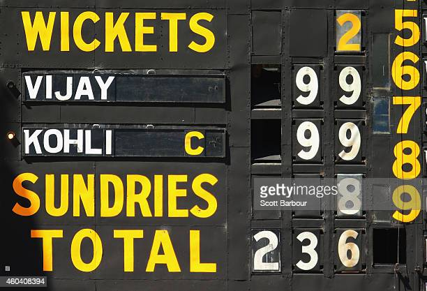 The scoreboard shows both Murali Vijay and Virat Kohli of India on 99 not out during day five of the First Test match between Australia and India at...