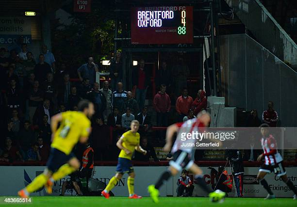 The scoreboard shows Oxford leading 40 during the Capital One Cup First Round match between Brentford and Oxford United at Griffin Park on August 11...