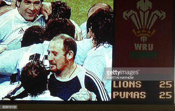 The scoreboard shows the Argentina players celebrating after they held the British Lions side to a 2525 draw at Cardiff's Millennium Stadium 23 May...