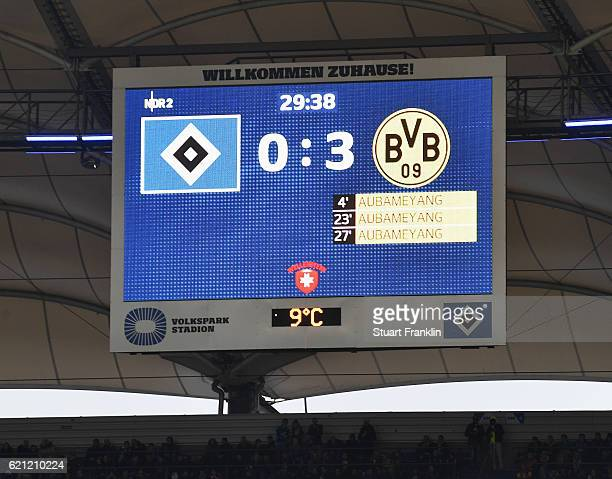 The scoreboard shows the hat trick of PierreEmerick Aubameyang of Dortmund during the Bundesliga match between Hamburger SV and Borussia Dortmund at...