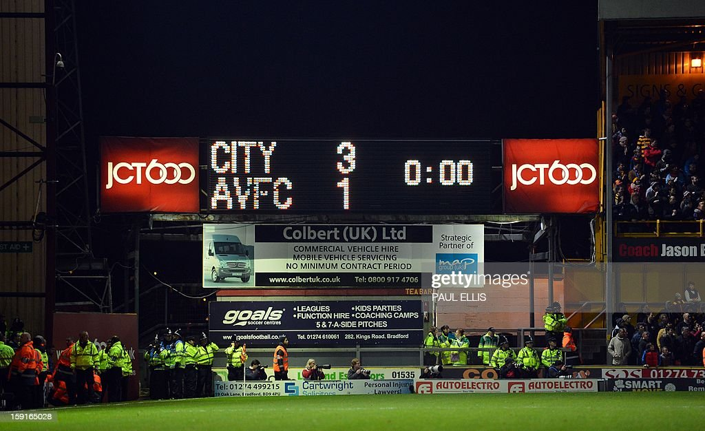 The scoreboard shows the result as League Two club Bradford City beat Premiership opposition Aston Villa 3-1 in the English League Cup semi-final first leg football match at The Coral Windows Stadium in Bradford, England on January 8, 2013. AFP PHOTO/Paul Ellis - RESTRICTED
